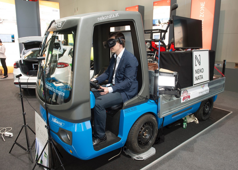 Person in a suit with virtual reality glasses in a mini-truck
